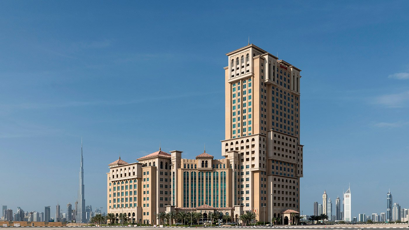 exterior of the marriott jaddaf hotel with the skyline at the back