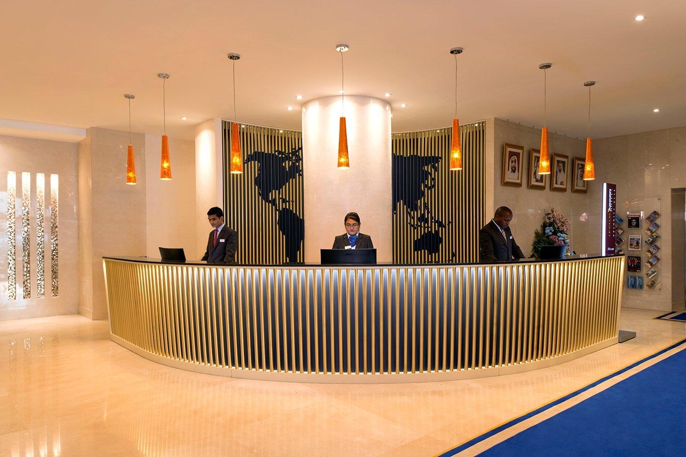 hotel reception of the mercure grand hotel in dubai