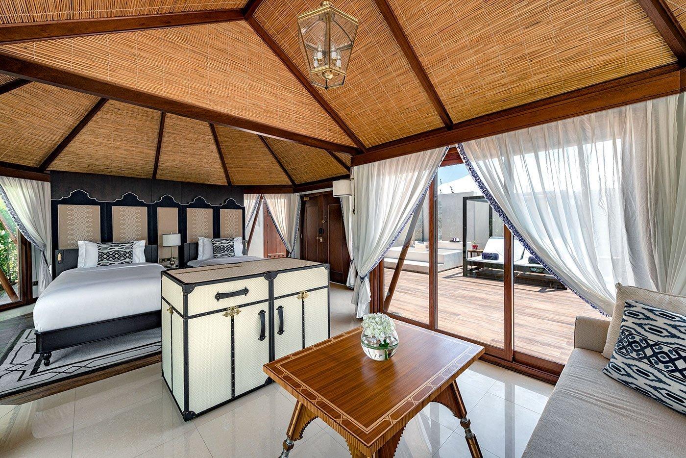 interior of a twin bed tent room at ritz carlton al hamra beach
