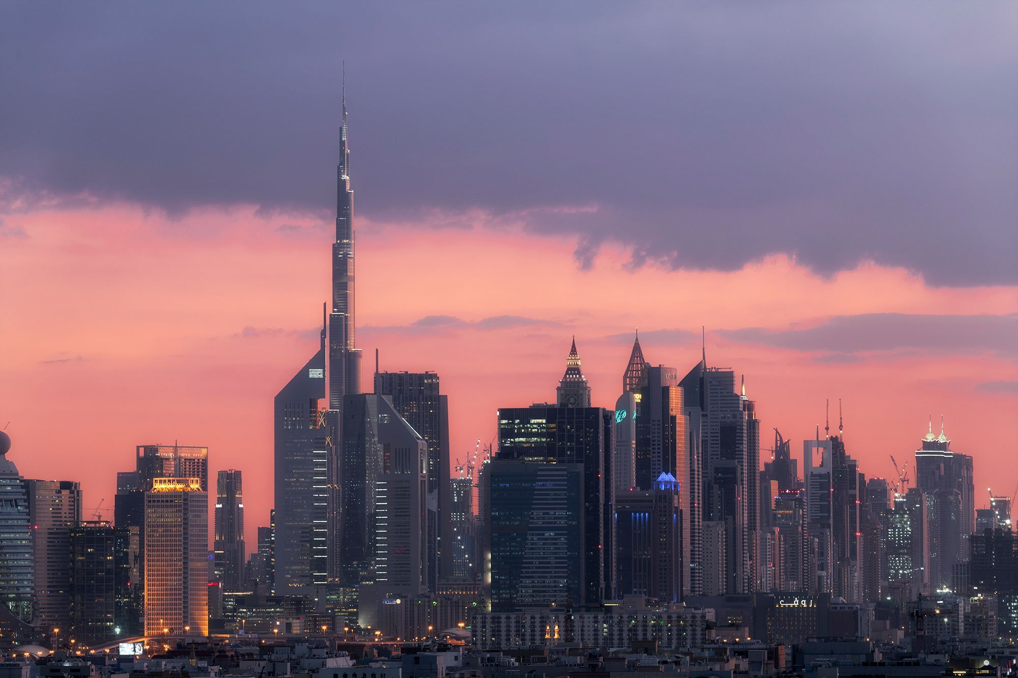 moody sunset over the architectural skyline of Dubai