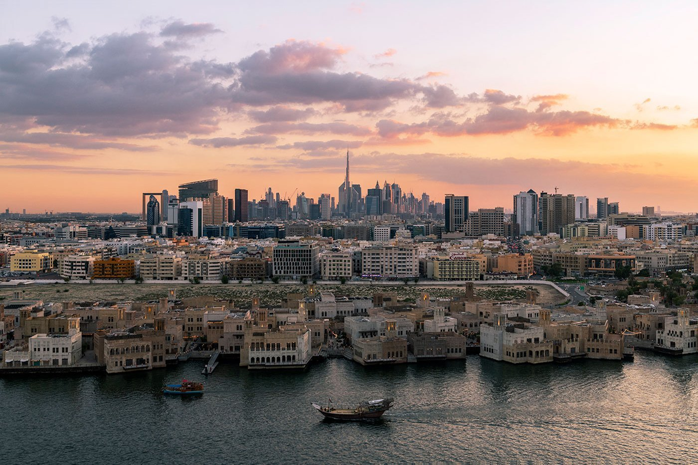 Dubai creek and skyline during sunset